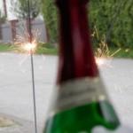 Einweihung der neuen Bank - Bild mit Sektflasche und Wunderkerzen